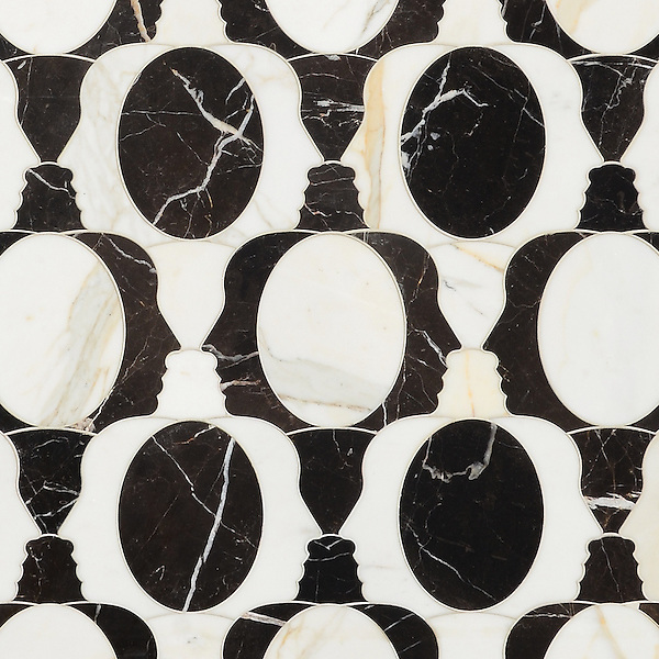 Janus, a waterjet mosaic, shown in polished Calacatta Tia and Saint Laurent, is part of the Illusions™ Collection by New Ravenna.
