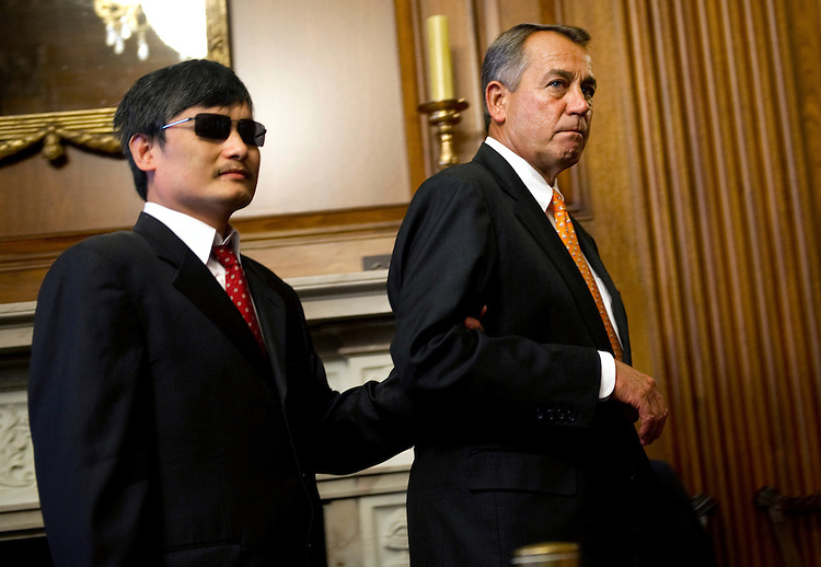 UNITED STATES - AUGUST 1: Chinese dissident Chen Guangcheng  is lead to a press conference in the U.S. Capitol by House Speaker John Boehner, R-Ohio. (Photo By Chris Maddaloni/CQ Roll Call)