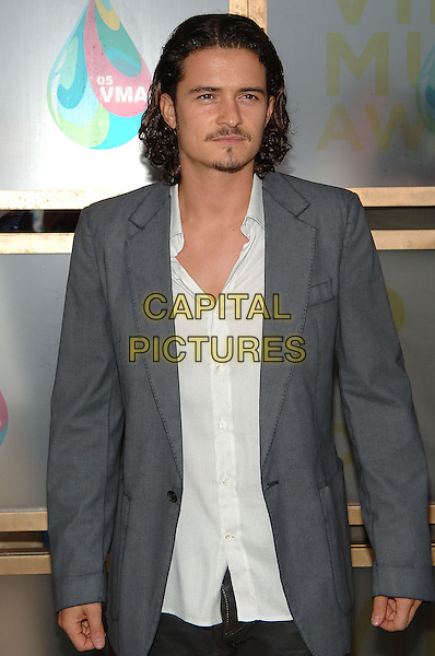 ORLANDO BLOOM.MTV Video Music Awards.Arrivals held at the American Airlines Arena,.Miami, 28th August 2005.half length grey gray jacket white shirt goatie beard mustache.Ref: ADM/JW.www.capitalpictures.com.sales@capitalpictures.com.© Capital Pictures.v-neck plunging neckline