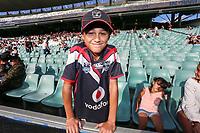 A young fan awaits kickoff. Sydney Roosters v Vodafone Warriors, NRL Rugby League. Allianz Stadium, Sydney, Australia. 31st March 2018. Copyright Photo: David Neilson / www.photosport.nz