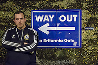 General view of a fan standing by a Way Out sign outside Stamford Bridge Stadium, home of Chelsea Football Club, ahead of the UEFA Champions League group match between Chelsea and FC Porto at Stamford Bridge, London, England on 9 December 2015. Photo by David Horn / PRiME