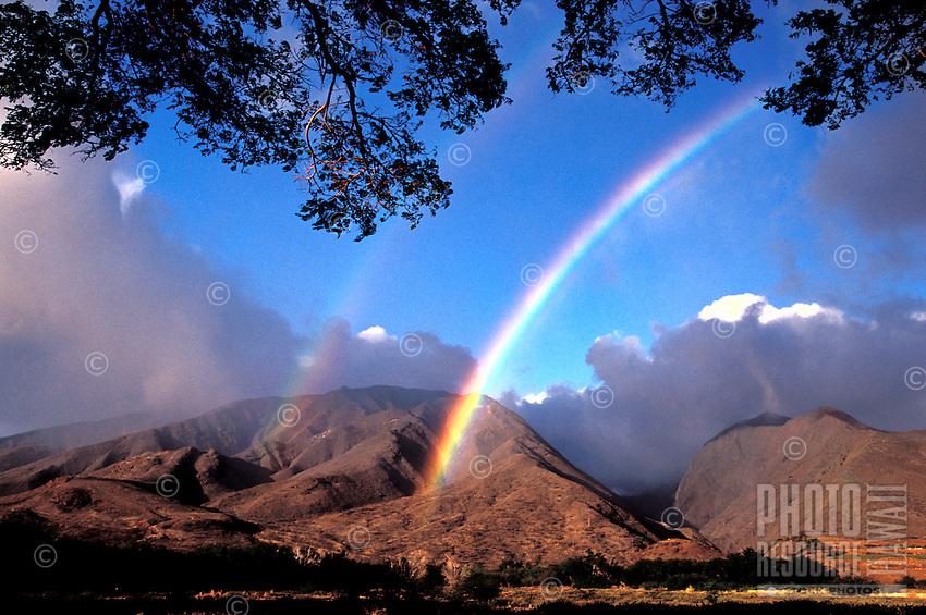 West Maui Mountains with a rainbow at Olowalu, Maui.