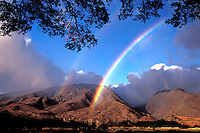 West Maui Mountains with a rainbow at Olowalu, Maui.