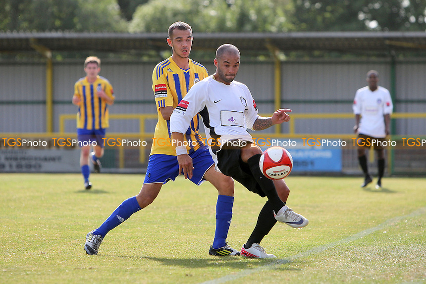Dean Carpenter of Dulwich shields the ball from Reece Hewitt of Romford - Romford vs Dulwich Hamlet - FA Trophy 1st Qualifying Round Football at Ship Lane, Thurrock FC - 15/09/12 - MANDATORY CREDIT: Gavin Ellis/TGSPHOTO - Self billing applies where appropriate - 0845 094 6026 - contact@tgsphoto.co.uk - NO UNPAID USE.