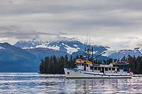 The M/V Discovery sits at anchor in College Fjord, Prince William Sound, Alaska.