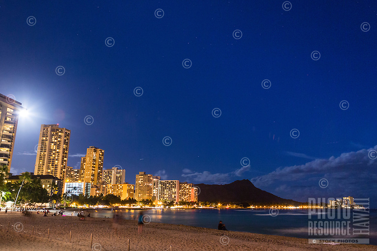 A night scene of Waikiki Beach with Diamond Head in the background, Honolulu, O'ahu.