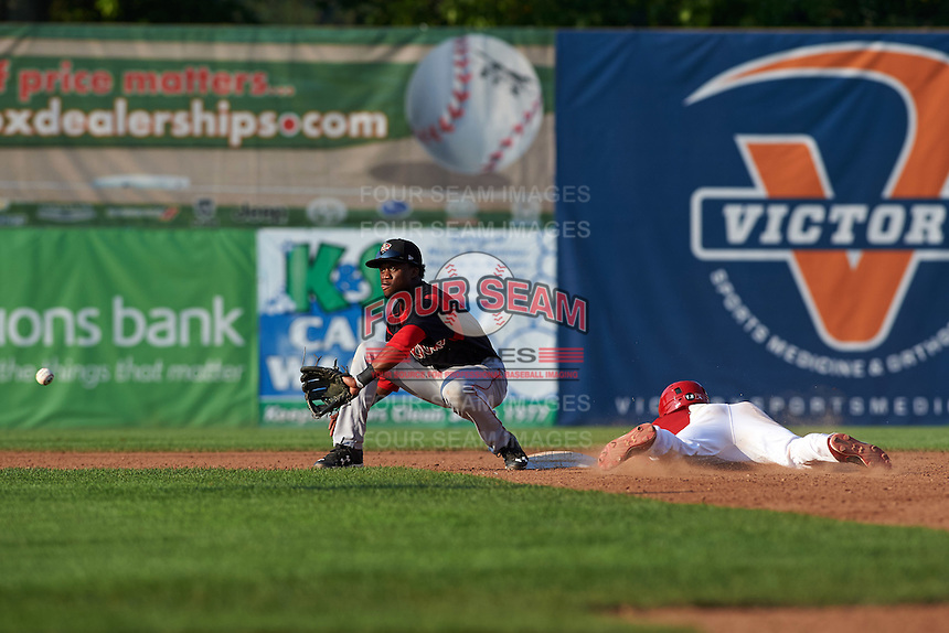 Batavia Muckdogs shortstop Anfernee Seymour (3) waits for a throw as Dalton Dulin slides into second during a game against the Auburn Doubledays on September 7, 2015 at Falcon Park in Auburn, New York.  Auburn defeated Batavia 11-10 in ten innings.  (Mike Janes/Four Seam Images)