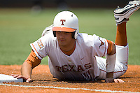 Third baseman Alex Silver #11 of the Texas Longhorns dives back to first after a pick off attempt against Texas Tech on April 17, 2011 at UFCU Disch-Falk Field in Austin, Texas. (Photo by Andrew Woolley / Four Seam Images)