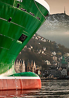 Bow of Havila Clipper, Havyard 832 Cd class oil tender moored in Bergen harbor with the Bryggen and Fløyen in background shot for Business Region Bergen.
