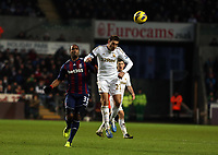 Saturday 19 January 2013<br /> Pictured: Angel Rangel of Swansea (R) heads the ball away from Cameron Jerome of Stoke (L)<br /> Re: Barclay's Premier League, Swansea City FC v Stoke City at the Liberty Stadium, south Wales.