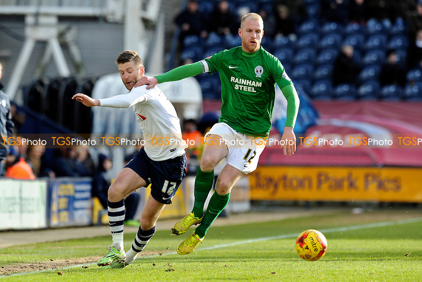 Neil Bishop of Scunthorpe United vies for the ball with Paul Gallagher of Preston North End - Preston North End vs Scunthorpe United - Sky Bet League One Football at Deepdale, Preston, Lancashire - 21/02/15 - MANDATORY CREDIT: Greig Bertram/TGSPHOTO - Self billing applies where appropriate - contact@tgsphoto.co.uk - NO UNPAID USE