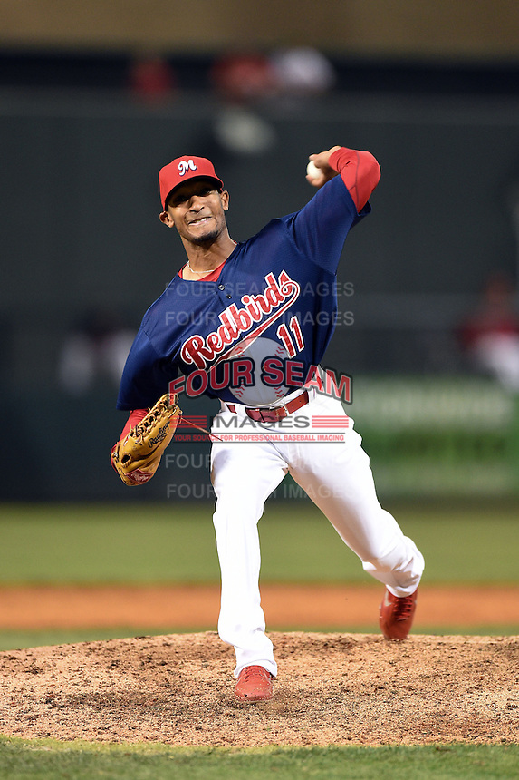 Memphis Redbirds pitcher Sam Freeman (11) delivers a pitch during a game against the Oklahoma City RedHawks on May 23, 2014 at AutoZone Park in Memphis, Tennessee.  Oklahoma City defeated Memphis 12-10.  (Mike Janes/Four Seam Images)