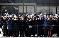 Former staff members watch as the flag-draped casket of former President George H.W. Bush is carried by a joint services military honor guard to Special Air Mission 41, Wednesday, Dec. 5, 2018, at Andrews Air Force Base, Md. <br /> Credit: Alex Brandon / Pool via CNP / MediaPunch