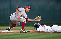 SANTA CLARA, CA - April 19, 2011: Kenny Diekroeger of Stanford baseball catches the throw from home on a steal attempt during Stanford's game against Santa Clara at Stephen Schott Stadium. Stanford won 10-3.