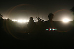 Soldiers with Bravo Troop, 1st Squadron, 40th Cavalry Regiment,  walk along a highway as they head out on a night raid targeting Sunni insurgents in the village of Adiwaniyah, about 10 miles south of Baghdad. Aug. 24, 2007. DREW BROWN/STARS AND STRIPES
