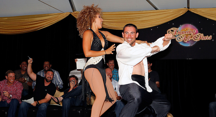 FORT MYERS, FL, March 2, 2012: Boston Red Sox catcher Daniel Butler dances with his partner as judges, from left, Ryan Sweeney, Franklin Morales, Carlos Silva, Kelly Shoppach, Jarrod Saltalamacchia, Felix Doubront, Cody Ross, Ross Ohlendorf and Justin Germano watch during the Dancing with the New Stars dance contest to benefit the Red Sox Foundation. (Brita Meng Outzen/Boston Red Sox)