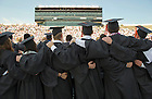 May 19, 2013; May 19, 2013; Graduates sing the Alma Mater at the close of the 2013 Commencement ceremony in Notre Dame Stadium. Photo by Barbara Johnston/University of Notre Dame