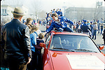GEN 8501-367<br /> <br /> 1984 National Championship Football Team Celebration Images. Robbie Bosco riding on a red car in Celebration Parade.<br /> <br /> January 1985<br /> <br /> Photo by Mark Philbrick/BYU<br /> <br /> &copy; BYU PHOTO 2009<br /> All Rights Reserved<br /> photo@byu.edu  (801)422-7322