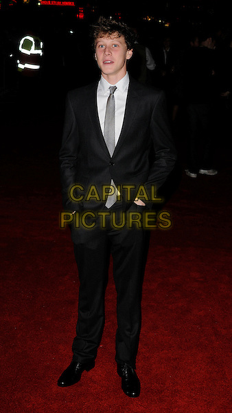 """GEORGE McKAY.""""The Boys Are Back"""" gala screening during the London Film Festival, Day 8, Vue West End cinema, Leicester Square, London, England..October 21st, 2009.LFF full length suit blue black white grey gray tie hands in pockets shirt.CAP/CAN.©Can Nguyen/Capital Pictures."""