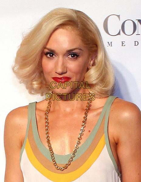 GWEN STEFANI.At Fashion Rocks held at Radio City Music Hall,.New Tork, 8th September 2005.portrait headshot white dress gold chain necklace red lips .Ref: ADM/JL.www.capitalpictures.com.sales@capitalpictures.com.© Capital Pictures.
