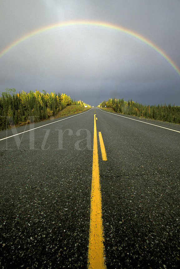Rainbow over Highway.  Alaska.