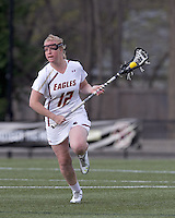 Boston College attacker Moira Barry (12) brings the ball forward. Boston College defeated University of Vermont, 15-9, at Newton Campus Field, April 4, 2012.