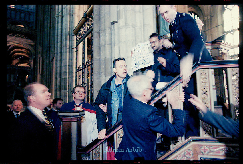 A member of the congregation punches Peter Tatchell's hand on the pulpit. <br />  Tatchell was  arrested and forcibly removed  after he and other Gay rights activists from 'Outrage'  occupied the pulpit at Canterbury Cathedral, during Archbishop Carey's Easter sermon,  April 1998. to protest against the Church's views on same sex marriage