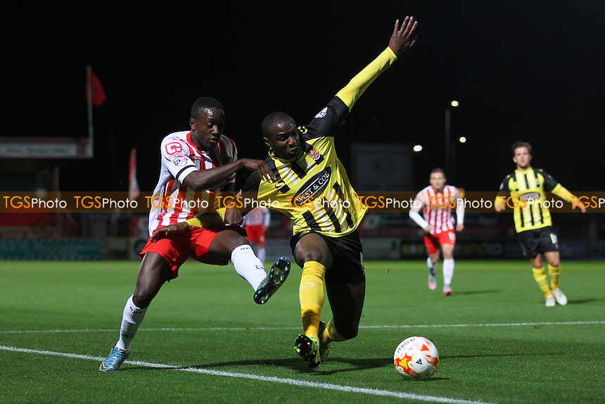 Clevid Dikamona of Dagenham and Redbridge and Jamar Loza of Stevenage during Stevenage vs Dagenham and Redbridge, Johnstone's Paint Trophy Football at the Lamex Stadium, Stevenage, England on 07/10/2015