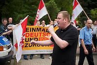 Ca. 20 NPD-Anhaenger marschierten am Samstag den 18. Mai 2013 zum Fluechtlingsheim in Wandlitz. Dort wurden sie von etwa 200 Buergern aus Wandlitz mit Laerm aus Troeten, Livemusik und Kochtoepfen empfangen. Von der NPD-Veranstaltung war ob des Laerms kein Wort zu verstehen und die Neonazis zogen entnervt wieder ab.<br />Im Bild: Ronny Zasowk, Brandenburger NPD-Vorsitzender und NPD-Parteivorstandsmitglied.<br />18.5.2013, Wandlitz<br />Copyright: Christian-Ditsch.de<br />[Inhaltsveraendernde Manipulation des Fotos nur nach ausdruecklicher Genehmigung des Fotografen. Vereinbarungen ueber Abtretung von Persoenlichkeitsrechten/Model Release der abgebildeten Person/Personen liegen nicht vor. NO MODEL RELEASE! Don't publish without copyright Christian-Ditsch.de, Veroeffentlichung nur mit Fotografennennung, sowie gegen Honorar, MwSt. und Beleg. Konto:, I N G - D i B a, IBAN DE58500105175400192269, BIC INGDDEFFXXX, Kontakt: post@christian-ditsch.de<br />Urhebervermerk wird gemaess Paragraph 13 UHG verlangt.]