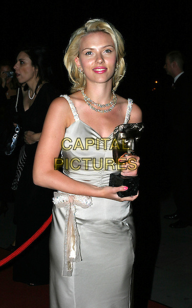 SCARLETT JOHANSSON.Best Actress In A Leading Role Award winner.Bafta Awards - British Academy Awards.15 February 2004.half length, half-length, long silver prada satin dress, pink lipstick nail varnish, bleach blonde peroxide hair.www.capitalpictures.com.sales@capitalpictures.com.© Capital Pictures.