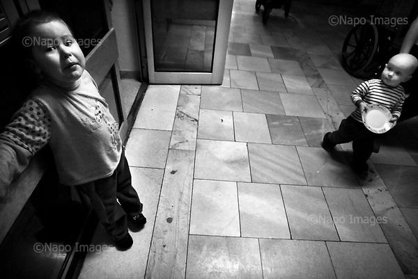 Wroclaw 02.02.2007 Poland.<br /> From the left: Patryk Dec,6 and child, 1.5 at corridor in hospital.<br /> Clinical Hospital, oncology and haematology departmend. This is one of the important Haematologic Hospital in all over Poland, however hospital board stopped to discharge a rising debt. In this connection authorities must close hospital, but goverment had no idea what should do with terminaly ill children.<br /> (Photo: Adam Lach / Napo Images)<br /> <br /> Akedemicki Szpital Kliniczny, oddzial onkologii i hematologii. Temu jednemu z najwazniejszych w Polsce osrodkowi szpitalnemu grozi zamkniecie w powodu dlugow, ktore niezaleznie od wplat NFZ-tu regularnie sciaga komornik. Z calej Polski ludzie charytatywnie wplacaja pieniadze by uratowac szpital i los dzieci dla ktorych to miejsce jest jedynym ratunkiem.
