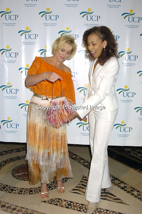 """Tonja Walker and Tamara Tunie ..at The United Cerebral Palsy's Fourth Annual """"Women Who Care"""" Luncheon on May 5, 2005 at Cipriani 42nd Street. ..Photo by Robin Platzer, Twin Images"""