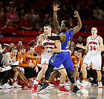 VERMILLION, SD - JANUARY 24: David Jenkins Jr. #5 and Tevin King #2 from South Dakota State University apply a double team to Matt Mooney #13 from the University of South Dakota during their game Wednesday night at the Sanford Coyote Sports Center in Vermillion, SD. (Photo by Dave Eggen/Inertia)