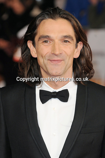 NON EXCLUSIVE PICTURE: PAUL TREADWAY / MATRIXPICTURES.CO.UK<br /> PLEASE CREDIT ALL USES<br /> <br /> WORLD RIGHTS<br /> <br /> English actor and film-maker Justin Chadwick attends the Royal film performance of &quot;Mandela: Long Walk to Freedom&quot; at the Odeon Theatre at Leicester Square in London, England.<br /> <br /> DECEMBER 5th 2013<br /> <br /> REF: PTY 137771