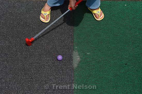 Kaysville - at Cherry Hill Tuesday June 9, 2009. .Garrett Frazier and Ciera McFarland miniature golfing. mini golf. spongebob squarepants sandals