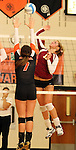 SIOUX FALLS, SD - OCTOBER 1:  Tagyn Larson #13 from Roosevelt looks to get a kill past Hannah Nieman #7 from Washington in the second game of their match Tuesday night at Washington. (Photo by Dave Eggen/Inertia)