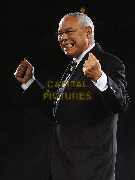 "GENERAL COLIN POWELL.Former Secretary of State General COLIN POWELL speaks to a sold out crowd at the ""Get Motivated!"" seminar held at the Mellon Arena, Pittsburgh, Pennsylvania, USA.  .August 11th, 2009    .half length hands fists black suit glasses gesture jacket smiling side view                     .CAP/ADM/JN.©Jason L Nelson/AdMedia/Capital Pictures."