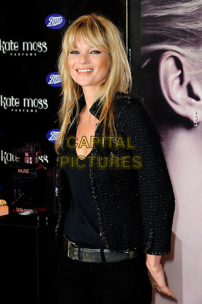 KATE MOSS.Kate Moss launches her new fragrance for women - 'Vintage Muse', Boots, Oxford Street, London, England..26th November 2010.half length fringe bangs hair black tweed jacket top belt.CAP/CAS.©Bob Cass/Capital Pictures.