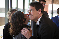 PQ Leadership candidates Pierre-Karl Peladeau and Martine Ouellet kiss during the presentation of parti Quebecois candidates for the upcoming byelection Tuesday May 5, 2015.