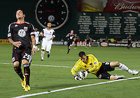 Santino Quaranta #25 of D.C. United  loses th ball to Kyle Reynish #24 of Real Salt Lake during an Open Cup match at RFK Stadium, on June 2 2010 in Washington DC. DC United won 2-1.