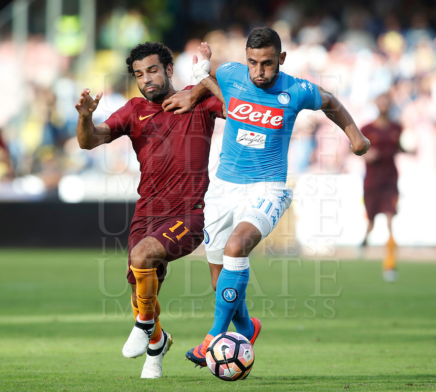 Calcio, Serie A: Napoli vs Roma. Napoli, stadio San Paolo, 15 ottobre. <br /> Napoli's Faouzi Ghoulam, right, is challenged by Roma's Mohamed Salah during the Italian Serie A football match between Napoli and Roma at Naples' San Paolo stadium, 15 October 2016. Roma won 3-1.<br /> UPDATE IMAGES PRESS/Isabella Bonotto