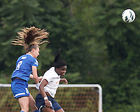 Boston Breakers defender Julie King (8) and Sky Blue FC forward Danesha Adams (9) battle for head ball.  In a National Women's Soccer League Elite (NWSL) match, Sky Blue FC (white) defeated the Boston Breakers (blue), 3-2, at Dilboy Stadium on June 16, 2013.