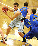 SIOUX FALLS, SD - NOVEMBER 24: Tom Aase #14 from the University of Sioux Falls looks for a teammate as Derek Meger #25 from Dakota State University defends in the first half of their game Monday night at the Stewart Center.  (Photo by Dave Eggen/Inertia)
