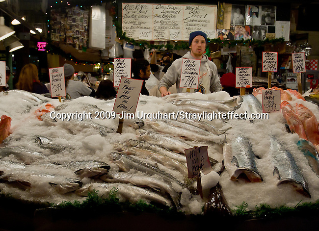 Jim Urquhart/Straylighteffect.com Fish monger Ryan Rector at the Pike Place Fish Market at the Pike Place Market in Seattle, Washington. 12/22/2009 - Jim Urquhart/Straylighteffect.com