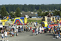 Festival arcade rides at Whaling Days, Silverdale, WA Kitsap County community event. Stock photography by Olympic Photo Group