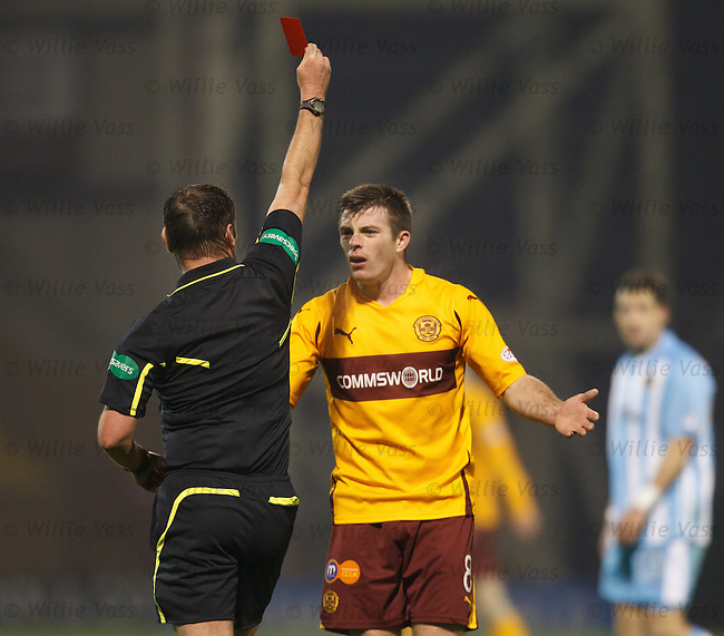 Referee Stevie O'Reilly reaches into his back pocket to show a red card to Motherwell player Steve Jennings. Bookmakers have opened an investigation into irregular betting patterns over this incident
