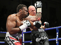Derek Chisora (Finchley, Union Jack shorts) defeats Paul Butlin (Melton Mowbray, black shorts) in a Heavyweight boxing contest at York Hall, Bethnal Green, promoted by Frank Warren / Sports Network - 22/05/09 - MANDATORY CREDIT: Gavin Ellis/TGSPHOTO - Self billing applies where appropriate - 0845 094 6026 - contact@tgsphoto.co.uk - NO UNPAID USE.