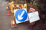 Sign and street furniture around Anglian water street working on domestic water main supply, Suffolk, England