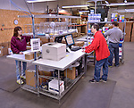 Warehouse photo showing employees conducting order fulfillment.