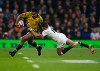 Australia's Samu Kerevi is tackled by England's Henry Slade<br /> <br /> Photographer Bob Bradford/CameraSport<br /> <br /> 2018 Quilter Internationals - England v Australia - Saturday 24th November 2018 - Twickenham - London<br /> <br /> World Copyright &copy; 2018 CameraSport. All rights reserved. 43 Linden Ave. Countesthorpe. Leicester. England. LE8 5PG - Tel: +44 (0) 116 277 4147 - admin@camerasport.com - www.camerasport.com